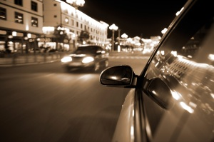 night drive ,shoot from the window of speed car, motion blur steet light.